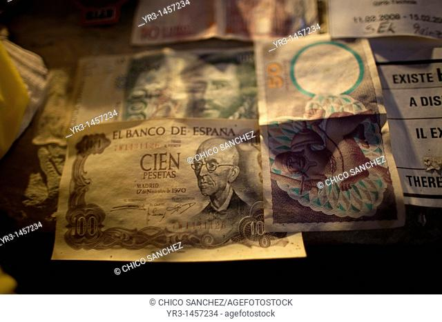 Old bills decorate a wall in Rabanal del Camino village, located in the French Way that leads to Santiago de Compostela, Maragateria region, Leon province