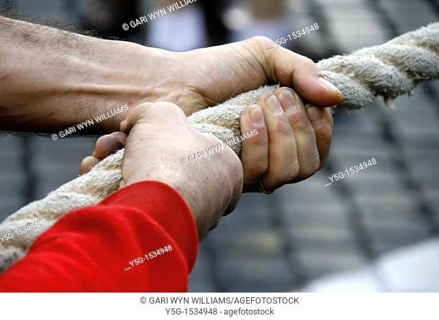 close up of hand in tug of war competition