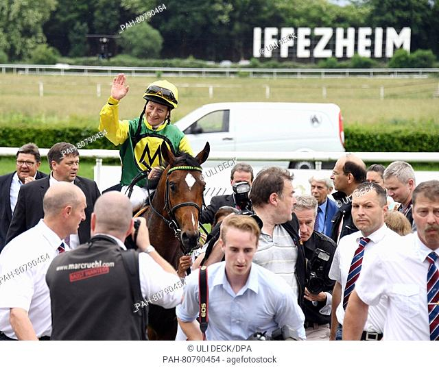 Jockey Norman Richter and his horse Iquitos winning the Grand Prix of the Badian Economy at the horse race track in Iffezheim, Germany, 29 May 2016