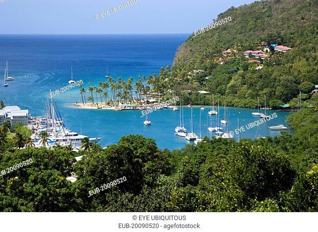 Marigot Bay The harbour with yachts at anchor the and lush surrounding valley
