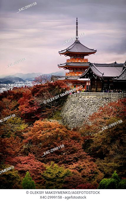 Kiyomizu-dera Sanjunoto pagoda in beautiful dramatic sunset autumn with colorful red trees. Higashiyama, Kyoto, Japan