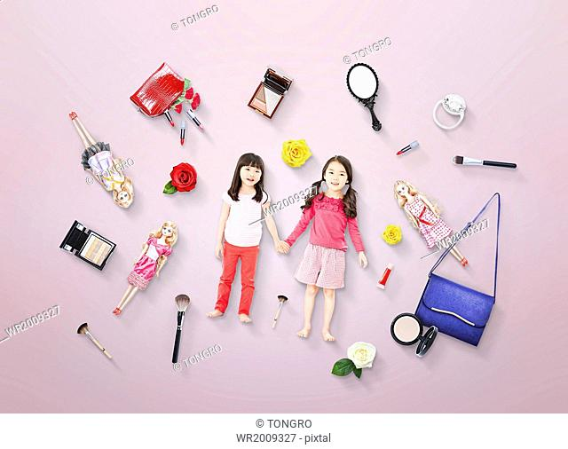 two girls surrounded by makeup