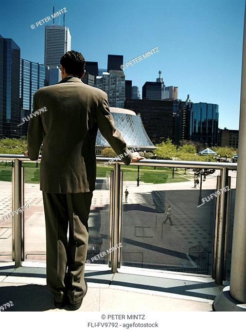 Businessman looking at City, Toronto, Ontario