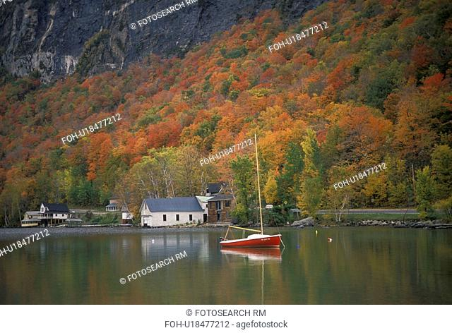 Vermont, fall, foliage, boat, Lake Willoughby, Westmore, Colorful fall foliage and a red sailboat reflect in the calm waters of Lake Willoughby in Orleans...