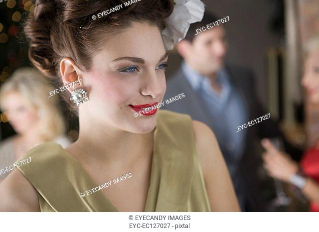 Close-up portrait of glamorous woman at holiday party