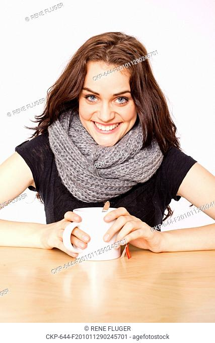 A beautiful young woman, lady, girl, cold, runny nose, headache, cup of tea, scarf CTK Photo/Rene Fluger , MR