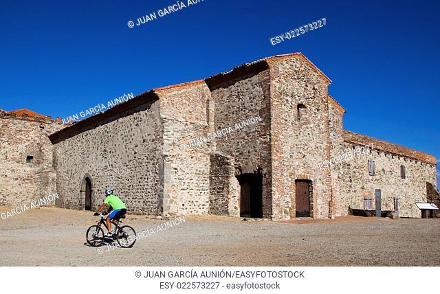 Biker climbing to the Tentudia Monastery hill, Badajoz, Spain
