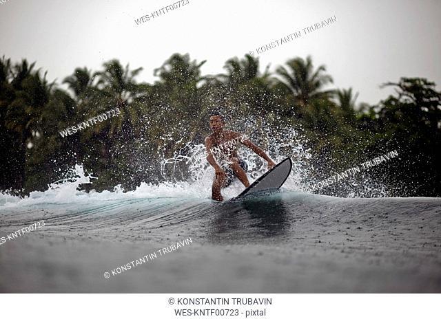 Indonesia, Java, surfer on a wave