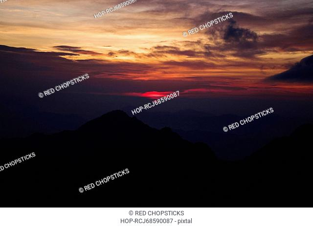 Silhouette of mountains at dusk, Huangshan Mountains, Anhui Province, China