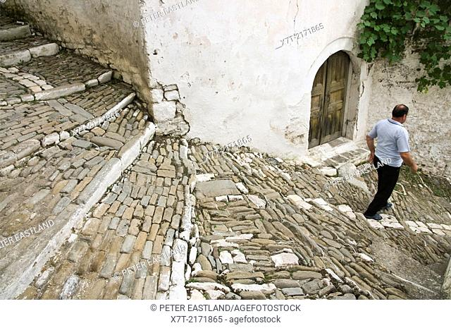 A typical narrow cobbled alleyway in the Mangalemi district of Berat in central Albania