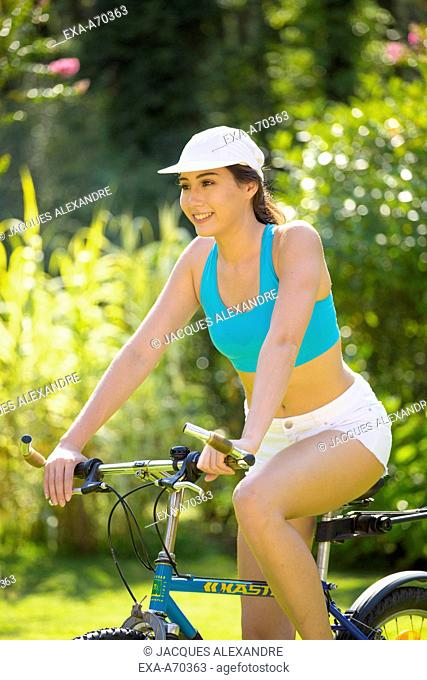 Woman with bicycle in forest