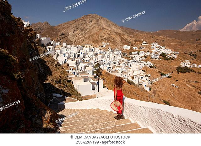 Woman on the stairs of the monastery in Hora, Serifos, Cyclades Islands, Greek Islands, Greece, Europe