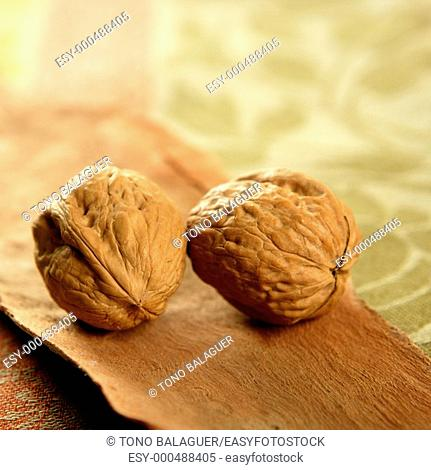 two walnut over tablecloth and wood
