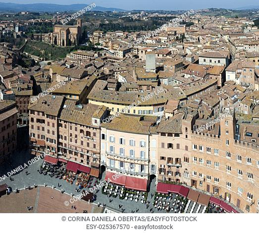 View of Siena roofs and Piazza del Campo from the Mangia Tower