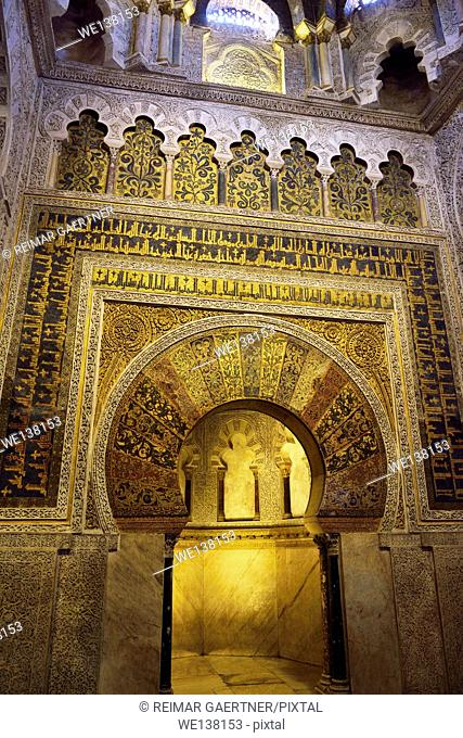 Mihrab qibla wall with gold mosaic design and caligraphy at the Prayer Hall of the Cordoba Cathedral Mosque
