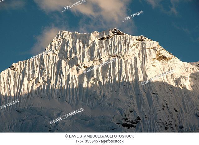 serrated ice walls of Amphu Lapcha peak in the Everest Region of Nepal