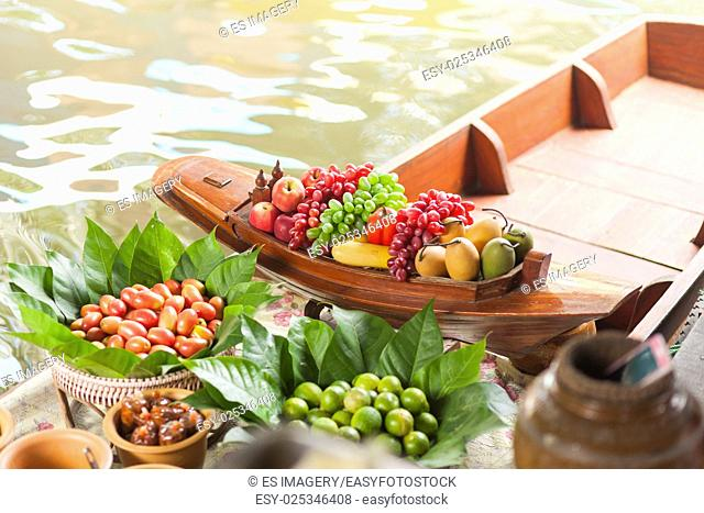 Limes, tomatoes, and assorted fruit in a floating kitchen, Thailand