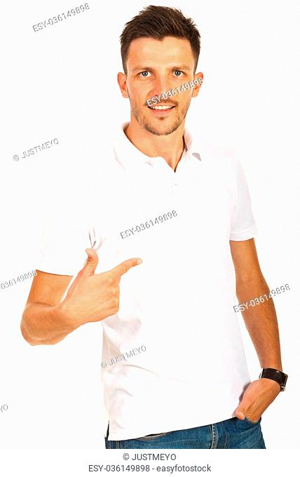 Man pointing to empty space of his t-shirt isolated on white background