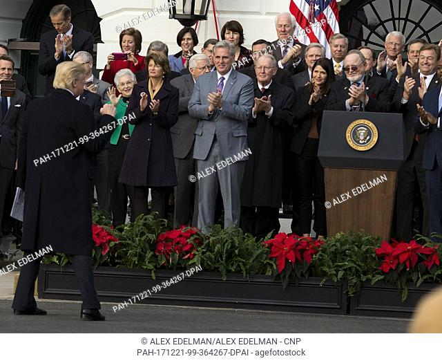 United States President Donald J. Trump raises his fist as he walks to the podium as Republican members of Congress look on during an event on the South Lawn of...