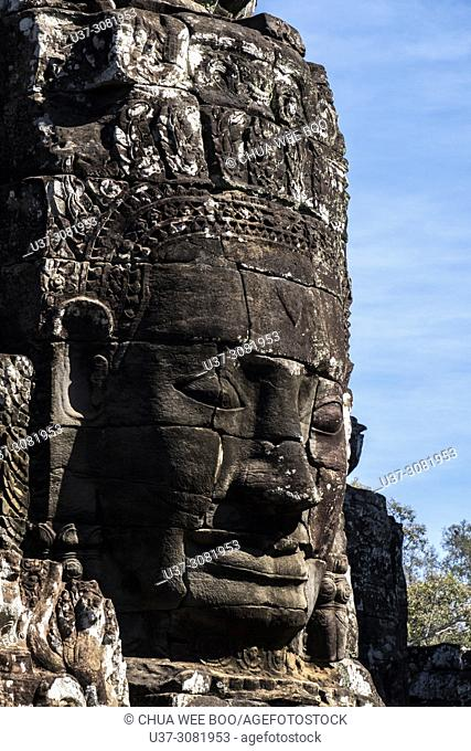 Detail of the stone faces on the bridge at the south gate of Angkor Thom, Angkor Temples complex, Cambodia, Asia