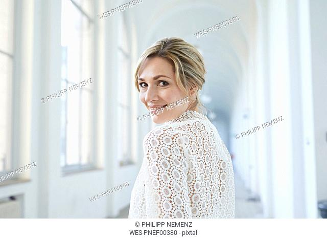 Portrait of blond bride, smiling