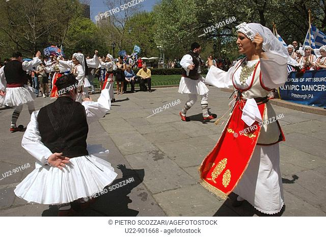 New York City (USA): Greek-Americans dancing sirtaki at Grand Army Plaza, in front of the Plaza Hotel, before the Greek Parade