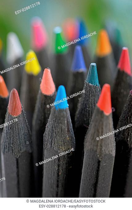 Colored black pencils in jar