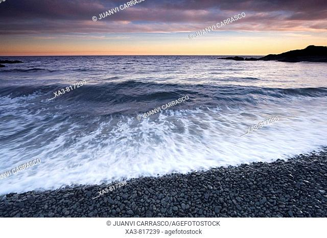 Black volcanic stone beach at sunset, Almeria province, Andalusia, Spain