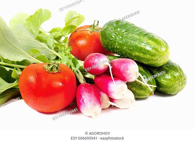 Fresh washed vegetables over white background