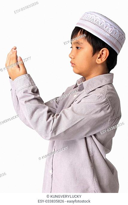 Asian child showing complete Muslim movements while praying