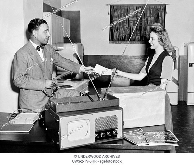 Ft. Worth, Texas 1950.A happy woman has her new Crowsley Suitcase TV 7 delivered to her home