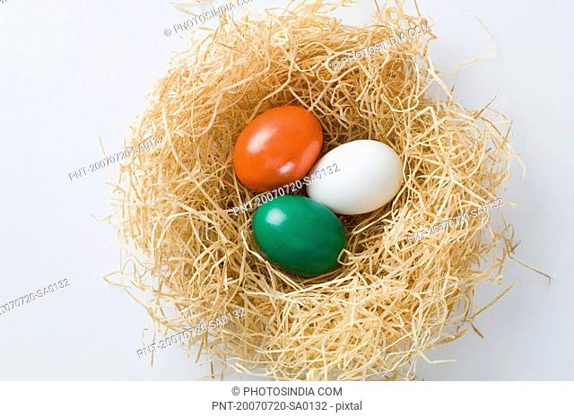 Close-up of three eggs painted in colors of Indian flag