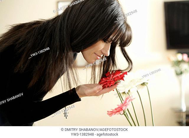 Portrait of Caucasian women near flowers