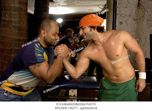 Bollywood Hindi film actor Saif Ali Khan with gym trainer Satya NO MR