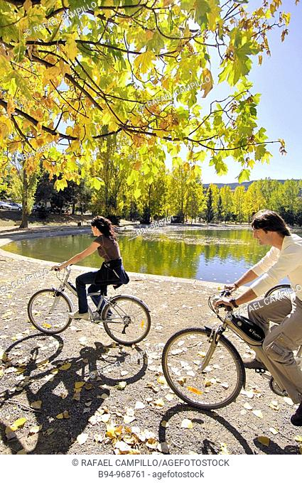 Cyclists by the Osseja lake in autumn. Languedoc-Roussillon, Pyrenees-Orientales, France