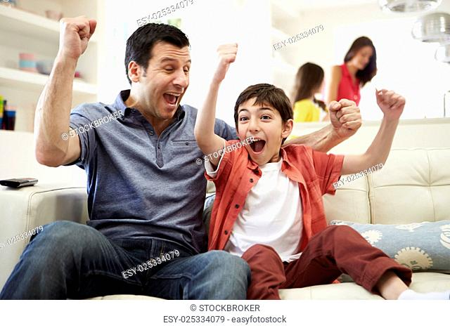 Father And Son Watching Sports On TV