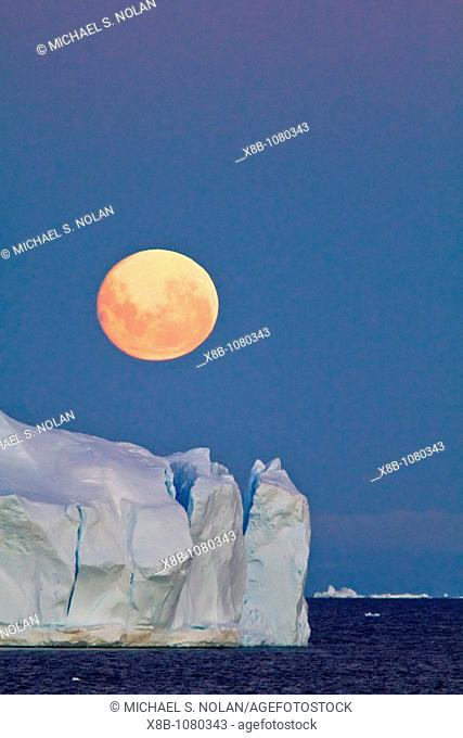 Full moon plus 1 day rising over icebergs in the Weddell Sea, Antarctica  MORE INFO This moonrise occurred on January 1, 2010