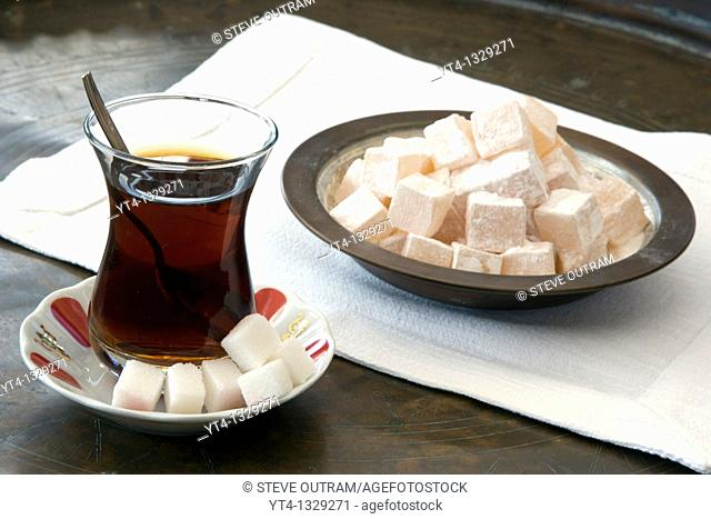 A glass of Turkish Tea and Bowl of Turkish Delight or Loukoum  Istanbul, Turkey