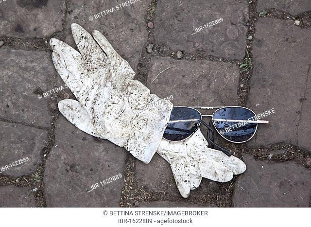 Love Parade 2010, disposable gloves used by emergency physicians and sunglasses in the underpass where many people died in a stampede, Duisburg, Ruhr Area