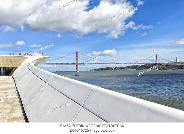 25 April Bridge, former Salazar bridge, over the Tagus river viewed from the MAAT – Museum of Art, Architecture and Technology, Lisbon, Portugal