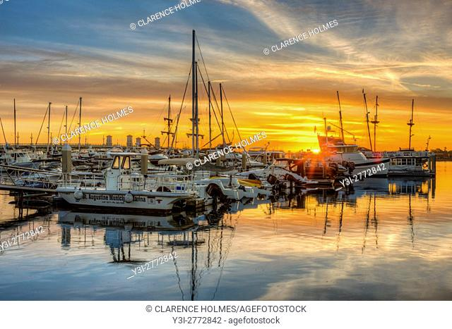 The sun rises over boats docked at the St. Augustine Municipal Marina in St. Augustine, Florida