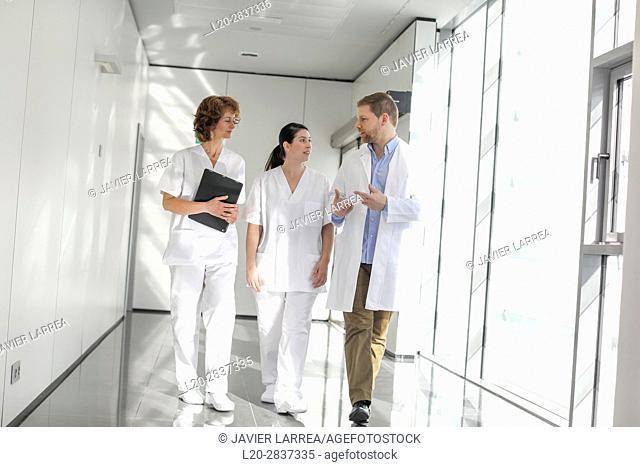 Doctors and nurses walking in corridor, Hospital, Spain