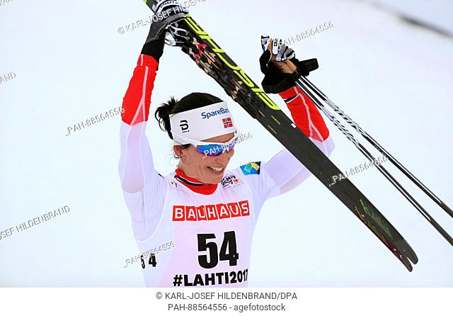 Marit Björgen from Norway celebrates at the finish line at the Nordic Ski World Championship in Lahti, Finland, 28 February 2017