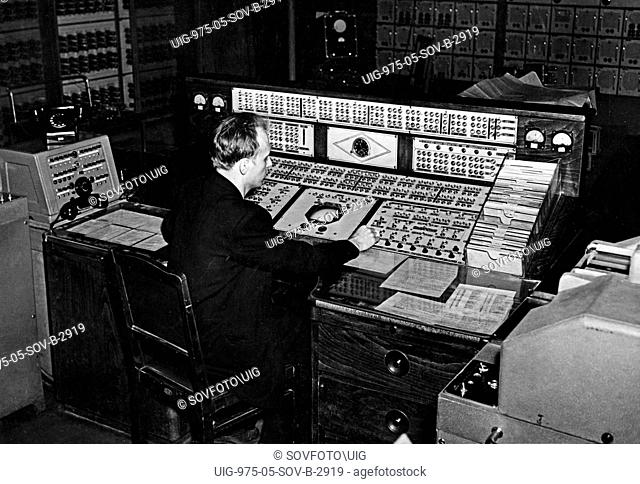 A technician at the control board of the strela-1, a general purpose computer at the calculating center of moscow's ussr academy of sciences, 1950s