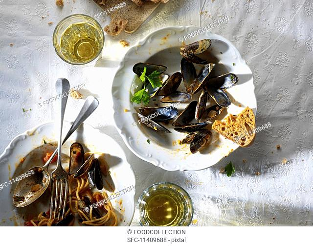 The remains of spaghetti and mussels on a plate