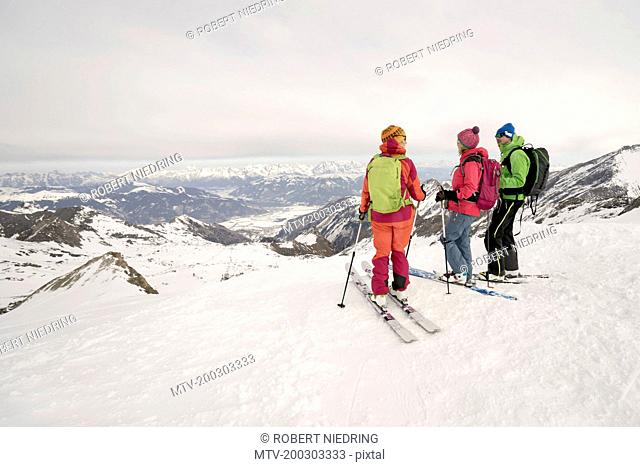 Ski tourers looking at mountains view, Zell am See, Austria