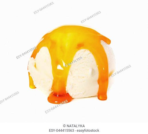 Vanilla ice cream ball with caramel syrup isolated on white background