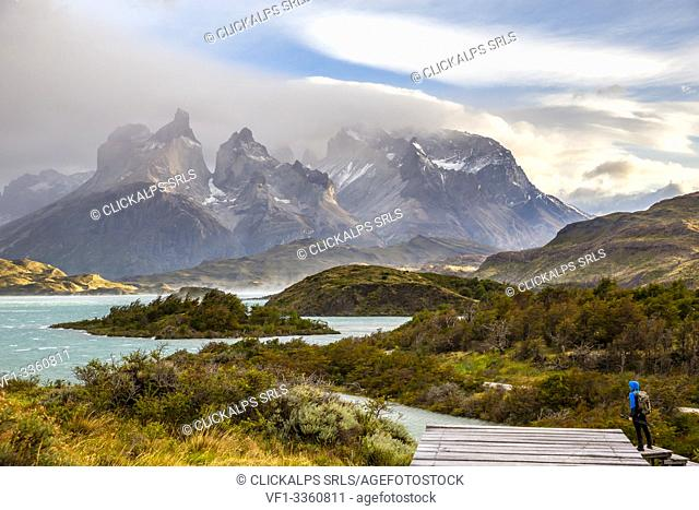 Chile,Patagonia,Magallanes and Chilean Antarctica Region,Ultima Esperanza Province,Torres del Paine National Park,a man admires the Paine Horns