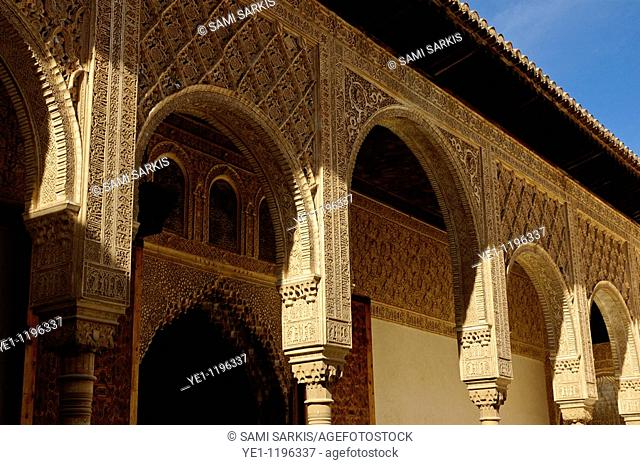 Colonnade and arches in the Patio de los Arrayanes area of Alhambra, a 14th-century palace in Granada, Andalusia, Spain