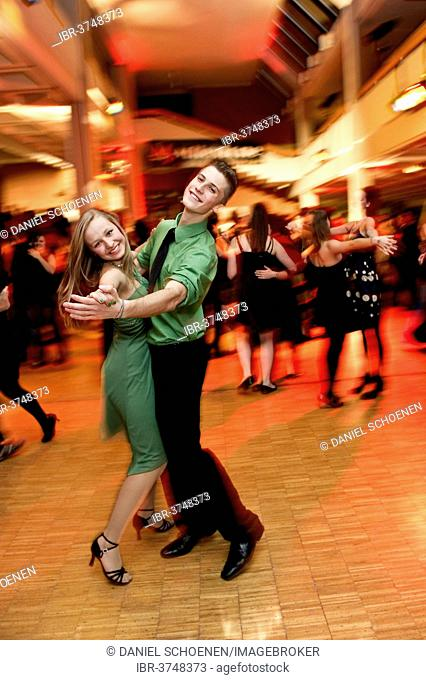 Young couple dancing at the prom of a dance school, Germany